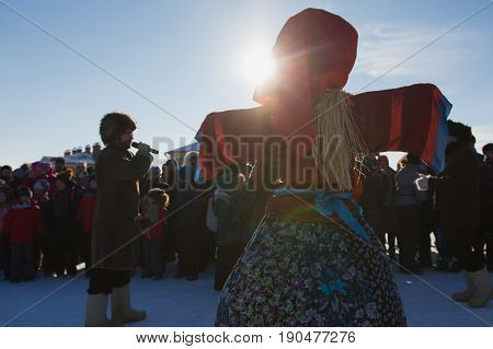 Kazan, Russia - 28 february 2017 - Sviyazhsk Island : Russian ethnic carnival Maslenitsa - A crowd of people gathered around an effigy of winter - the man leading talks into the microphone