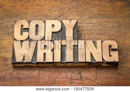 copywriting word in letterpress printing blocks against rustic wood
