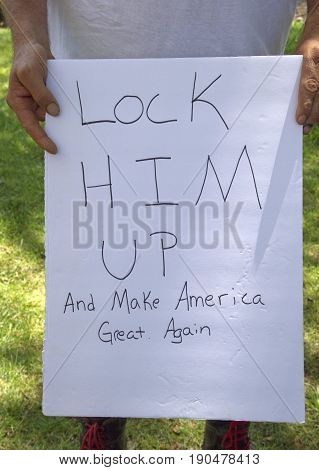 Asheville, North Carolina, USA - June 3, 2017: Close up of a political sign held by a man at a