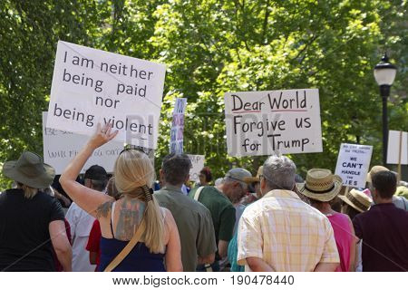 Asheville, North Carolina, USA - June 3, 2017: Close up of a crowd of political protesters holding signs at a peaceful