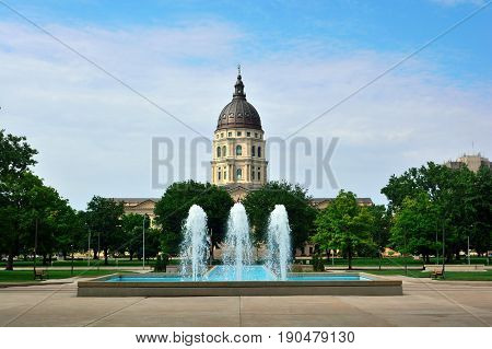 Kansas State Capitol Building with Fountains on a Sunny Day