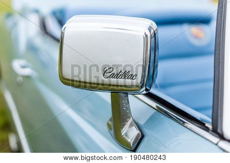 PAAREN IM GLIEN GERMANY - JUNE 03 2017: Rear view mirror of a full-size personal luxury car Cadillac Eldorado (Seventh generation). Exhibition