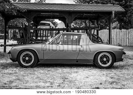 PAAREN IM GLIEN GERMANY - JUNE 03 2017: Sports car Porsche 914 Targa. Black and white. Exhibition