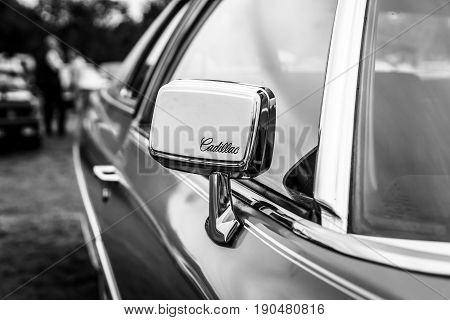 PAAREN IM GLIEN GERMANY - JUNE 03 2017: Rear-view mirror of the Cadillac Coupe de Ville. Black and white. Exhibition