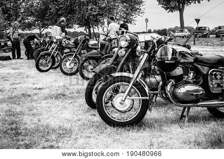 PAAREN IM GLIEN GERMANY - JUNE 03 2017: Various retro motorcycles stand in a row. Black and white. Exhibition