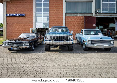 PAAREN IM GLIEN GERMANY - JUNE 03 2017: Chevrolet Chevelle SS396 Hardtop Coupe (left) Dodge Power Wagon W100 (center) and Chevrolet C-10 Fleetside (right). Exhibition