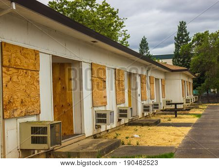 Abandoned Units With Boarded Up Windows & Doors