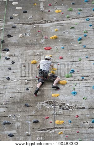VIENNA, AUSTRIA-JUNE 01, 2017: Climbing at the large artificial wall at the House of the Sea, Vienna, Austria