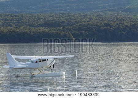 water propeller plane floating on fresh water lake