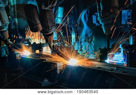 Industrial welding robots are movement welding in production line