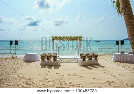 Wedding on the beach . Wedding arch decorated of flowers on tropical sand beach. Wedding and honeymoon concept.
