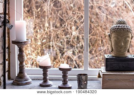 Extinguished candle in candlestick. Vintage decoration in boho style. Decoration in oriental style.