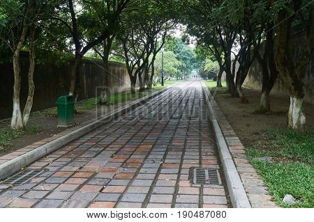 Empty footpath on a foggy day in the imperial city in Hue, Vietnam