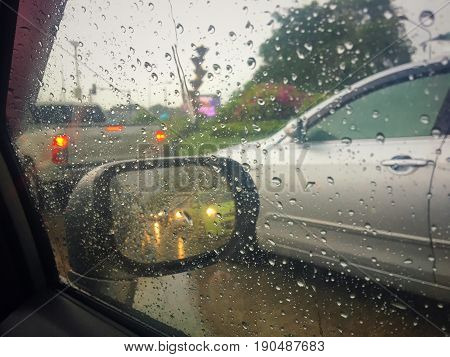 Typhoon on the road in southeast asia pacific , Driving under the rain weather