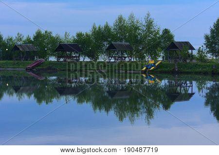 Beautiful sunlight shining on a lake with a mirror like reflections.