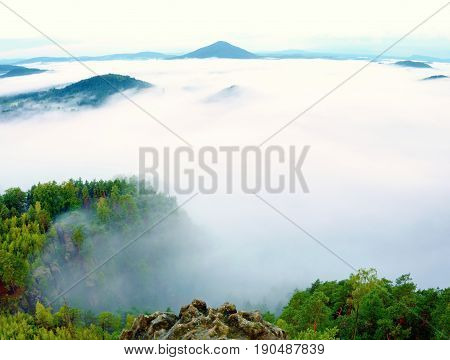 Magnificent Heavy Mist In Landscape. Autumn Creamy Fog In Countryside. Hill Increased From Fog,
