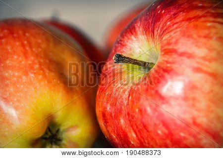 Red big apples fruit  background. Close up