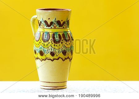 Earthenware figurines decorative figurines vase isolated on a yellow background