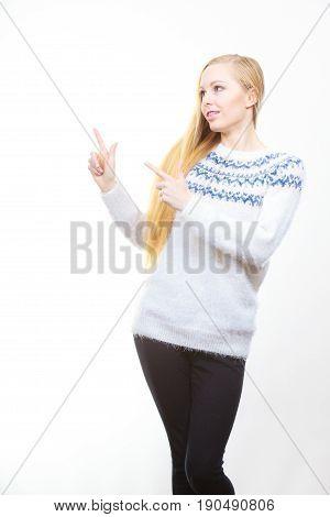 Teenage Blonde Woman Pointing At Copyspace