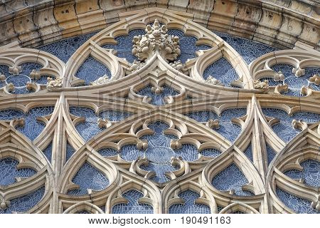 14th century St. Vitus Cathedral rose window facade Prague Czech Republic. It is a Roman Catholic metropolitan cathedral in Prague the seat of the Archbishop of Prague.