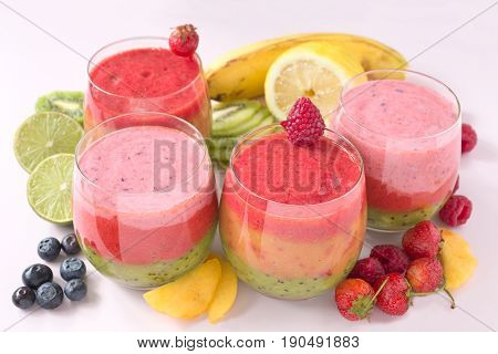 Mixed fruit smoothie with raspberries, kiwi and strawberry.