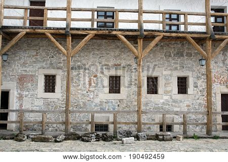 medieval castle yard old wooden balcony woden stairs