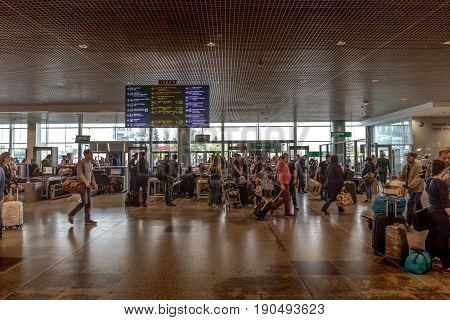 MOSCOW, RUSSIA - May 29, 2017: Domodedovo airport inside interior with passengers. Preflight inspection of passengers' luggage in Entrance to the airport