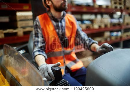 Forklifter working on loading machine