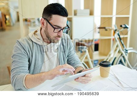 Business analyst with touchpad working online