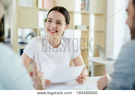 Young job seeker with resume talking to employers