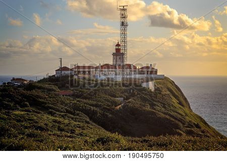The lighthouse in Cabo da Roca. Cliffs and rocks on the Atlantic ocean coast in Sintra in a beautiful spring day Portugal