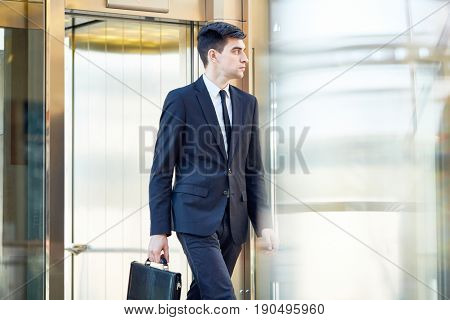 Serious banker with briefcase going to work
