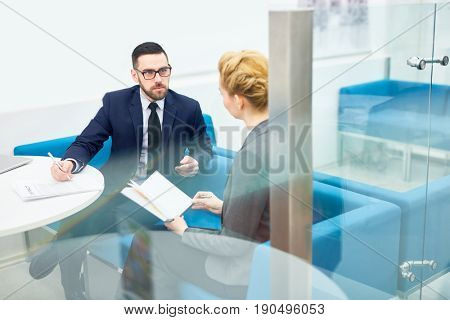 Employer and employee having discussion in office