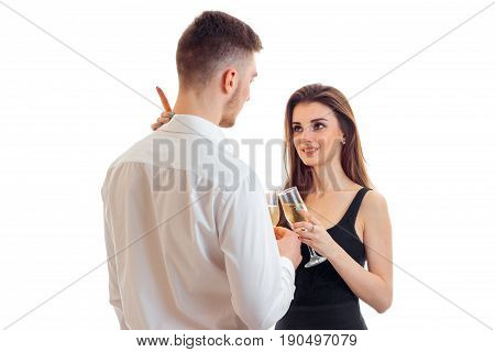 couple flirting and drinking champagne isolated on white background