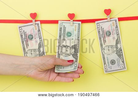 Fifty Dollars In Hangs On The Clothespins, Yellow Background