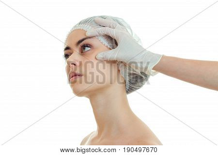 Portrait of a young girl in a special medical hair hat the doctor Cabinet is isolated on a white background close-up