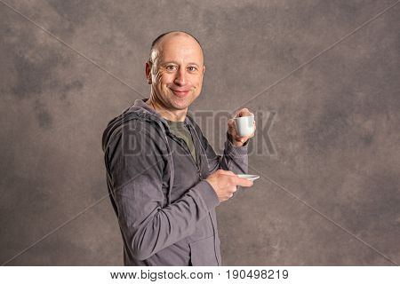 Young Baldheaded Man Drinking Coffee