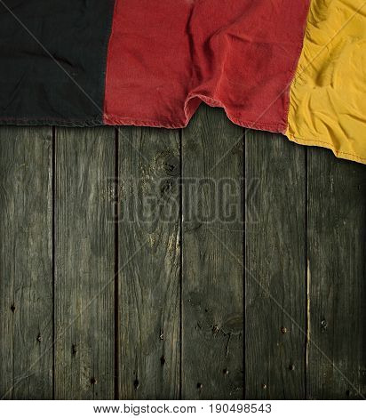 flag of the Federal Republic of Germany on old wooden planks