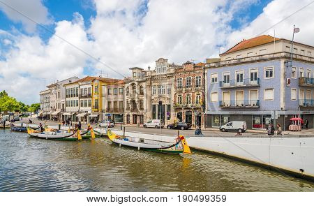 AVEIRO,PORTUGAL - MAY 12,2017 - View at the buildings near canal in Aveiro. Aveiro is located on the shore of the Atlantic Ocean.Aveiro is an industrial city with an important seaport.