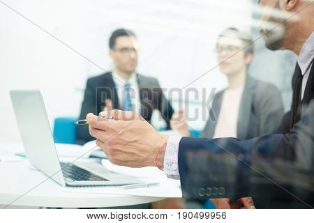 Young economist showing financial data to colleagues