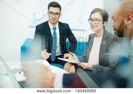 Team of co-workers working over project in office