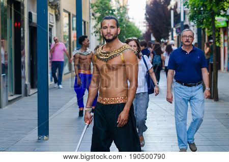 Madrid Spain - june 09 2017: Two man bollywood dancers are performing in the streets Menacho of Badajoz