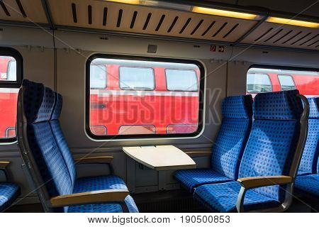 Modern Train Wagon Interior Seats Rows Blue Transportation White Daytime Traveling Empty