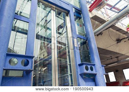 Subway Station Glass Elevator Doors Closed Waiting Looking Up Perspective Modern Architecture Urban
