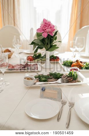 Blank Card For Guests Near White Empty Plate On Dinner Table For Wedding Banquet, Free Space For Tex