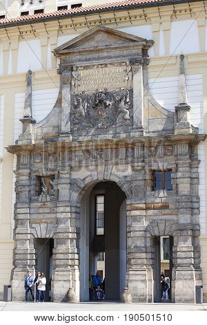 PRAGUE CZECH REPUBLIC - APRIL 30 2017 : Prague Castle Hradcany entrance gate. Castle is dating from the 9th century. It is the official residence of the President of the Czech Republic