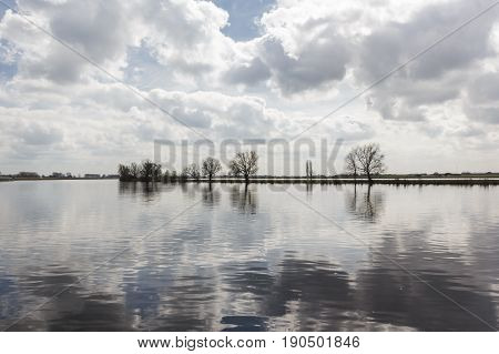 Lake with trees and sky reflection around Giethoorn Holland , Venice of Holland