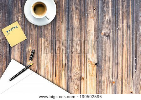 wooden office desk with blank paper paper note and cup of coffee
