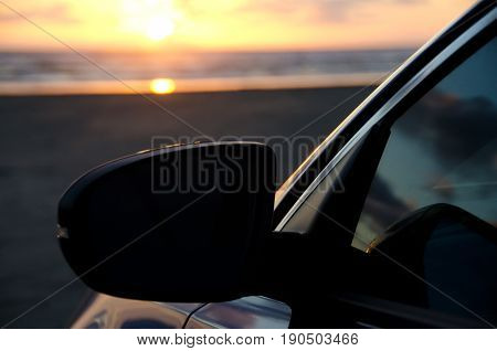 Contrasted Mirror Of A Blue Sport Sedan Under Dusk Lights At Sand Beach