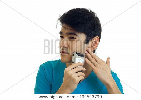 Portrait of a young handsome guy with black hair that turned my head sideways and shaves isolated on white background